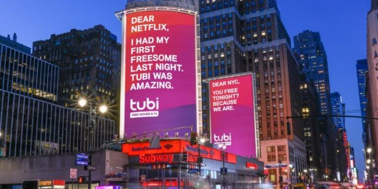 """Tubi's digital billboards, one saying """"Dear Netflix, I had my first freesome last night."""", one saying """"Dear NYC, you free tonight? Because we are."""""""