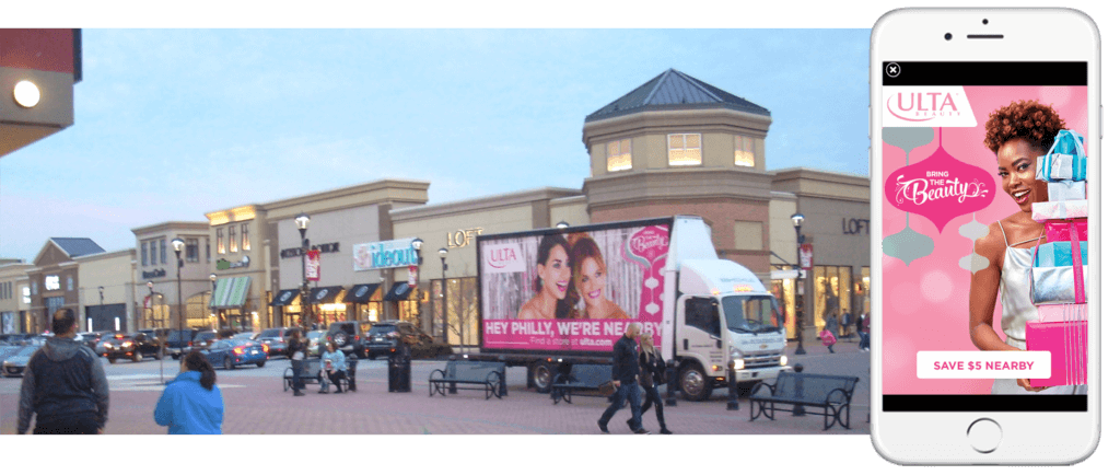 Photo showing an Ulta advertisement appearing on both a smartphone and a truckside billboard.