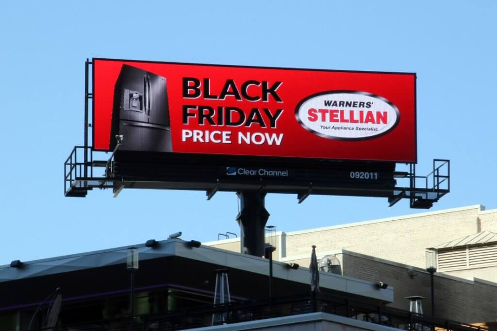 An image of a large billboard for Warner's appliances. The ad is promoting their Black Friday sale on fridges with an image of a fridge on the left-hand side.