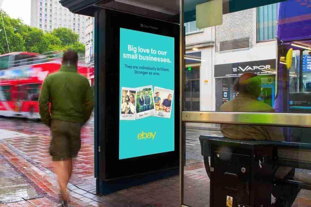 """Image of bus shelter advertisement from Ebay saying """"Big love to our small businesses. They are individually brilliant. Stronger as one."""""""