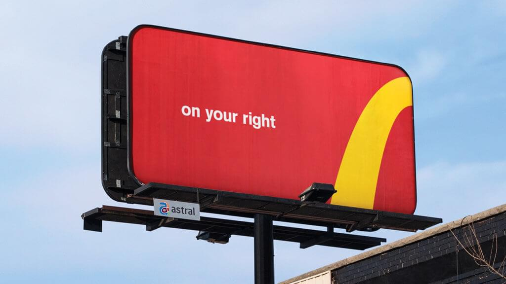 "Image of McDonald's OOH billboard giving directions to its nearest restaurant location. Ad says, ""On your right"" with a McD's golden archway pointing to the right direction."