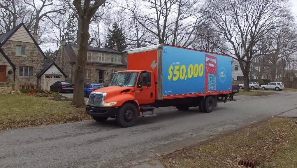 Photo of mobile billboard advertisement on the isde of a truck advertising Ontario's Lottery & Gaming (OLG).