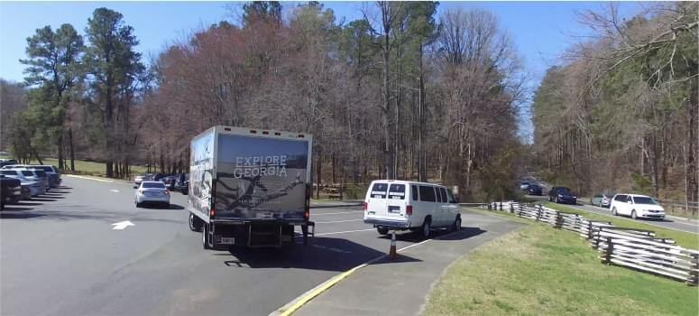 An image of a wrapped truck with advertisement for Explore Georgia.